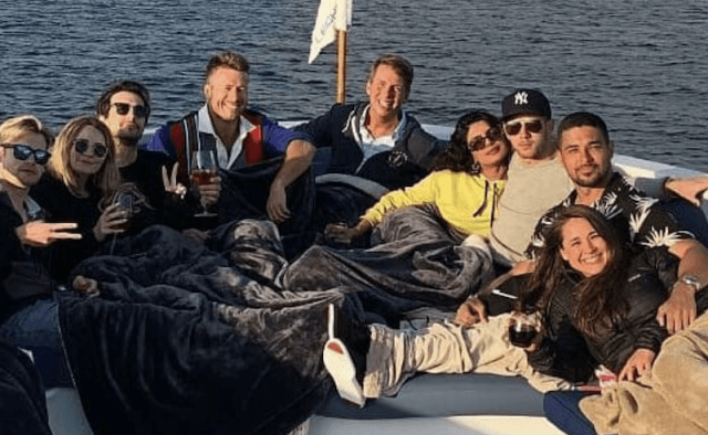 Priyanka Chopra and Nick Jonas hanging out with friends on a boat.