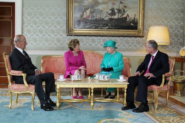 Prince Philip The Duke of Edinburgh, President Mary McAleese, Queen Elizabeth II, and Dr. Martin McAleese talk over a cup of tea