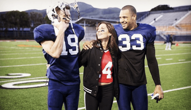 Clay Harbor smiling while wrapping his arm around Rebecca Kufrin.