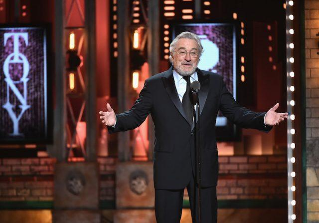 Robert De Niro speaking on stage.
