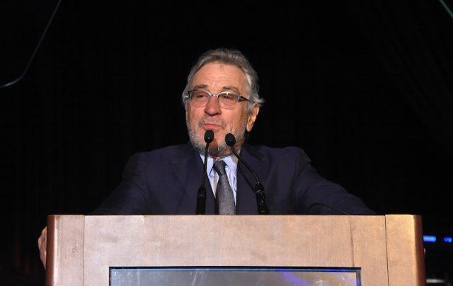Robert De Niro behind a podium.
