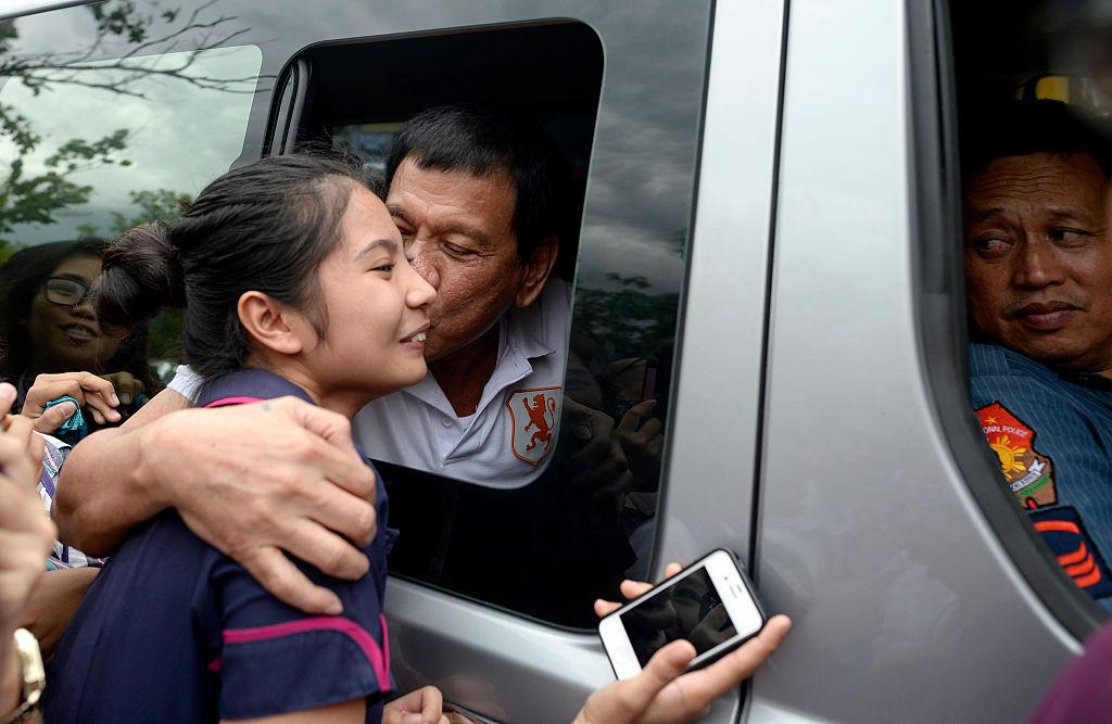 Rodrigo Duterte kissing a fan