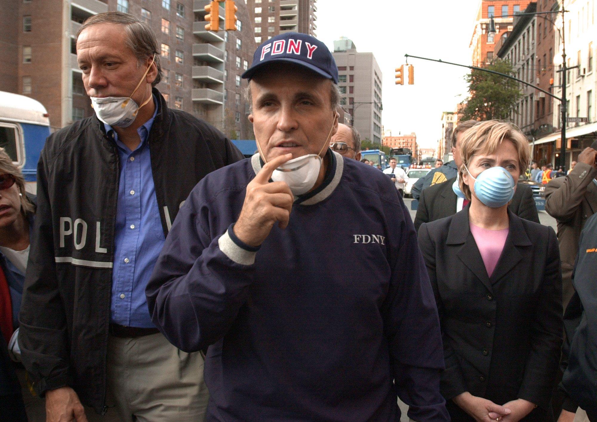 New York Governor George Pataki (L), New York City Mayor Rudolph Giuliani (C) and US Senator Hillary Rodham Clinton tour world trade center after 9/11