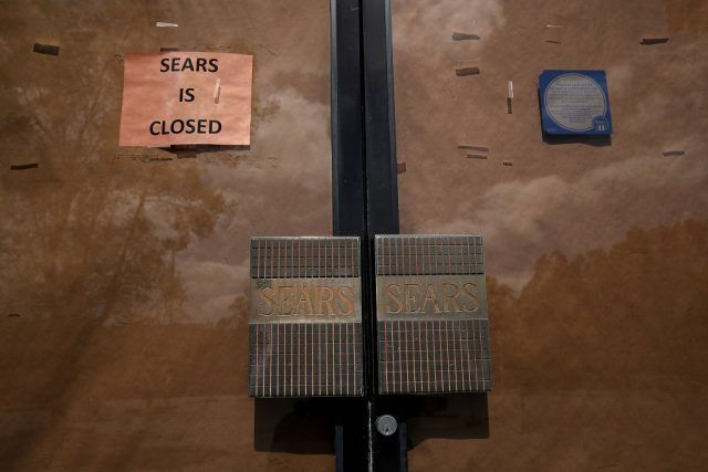 A sign is posted on the door of a closed Sears store on May 31, 2018 in San Rafael, California
