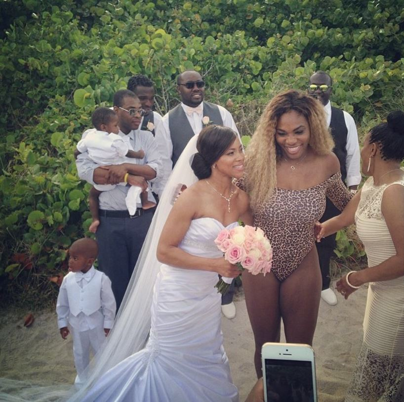 Serena Williams greets the bride.