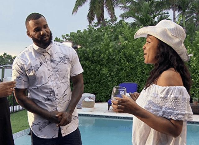 The Game chatting with a woman.