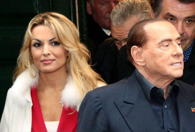 Francesca Pascale wearing a white jacket and red shirt.