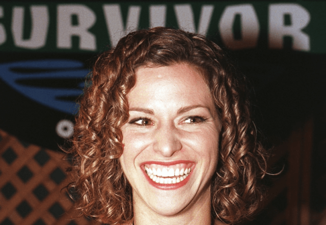 Stacey Stillman smiling while at a red carpet event.