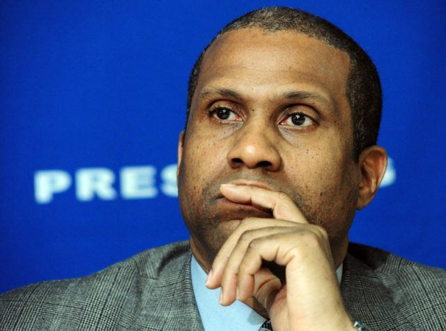 Tavis Smiley looking pensive during a press conference.