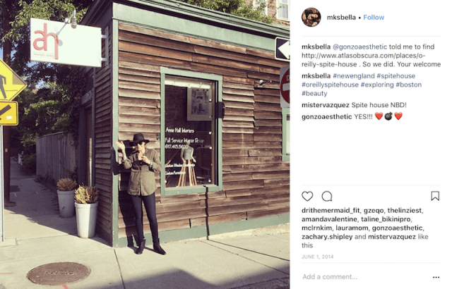 A woman standing at the O'Reilly spite house.