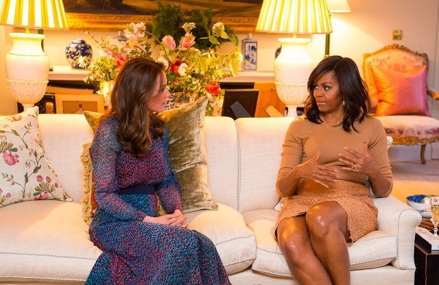 Catherine, Duchess of Cambridge, speaks with Michelle Obama in the Drawing Room of Apartment 1A Kensington Palace