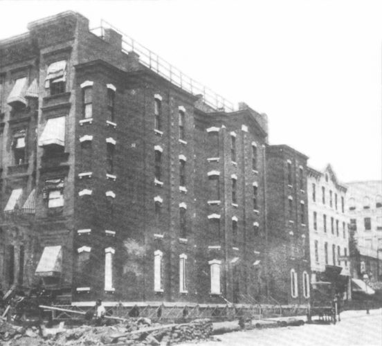 The spite house in a black and white photo.