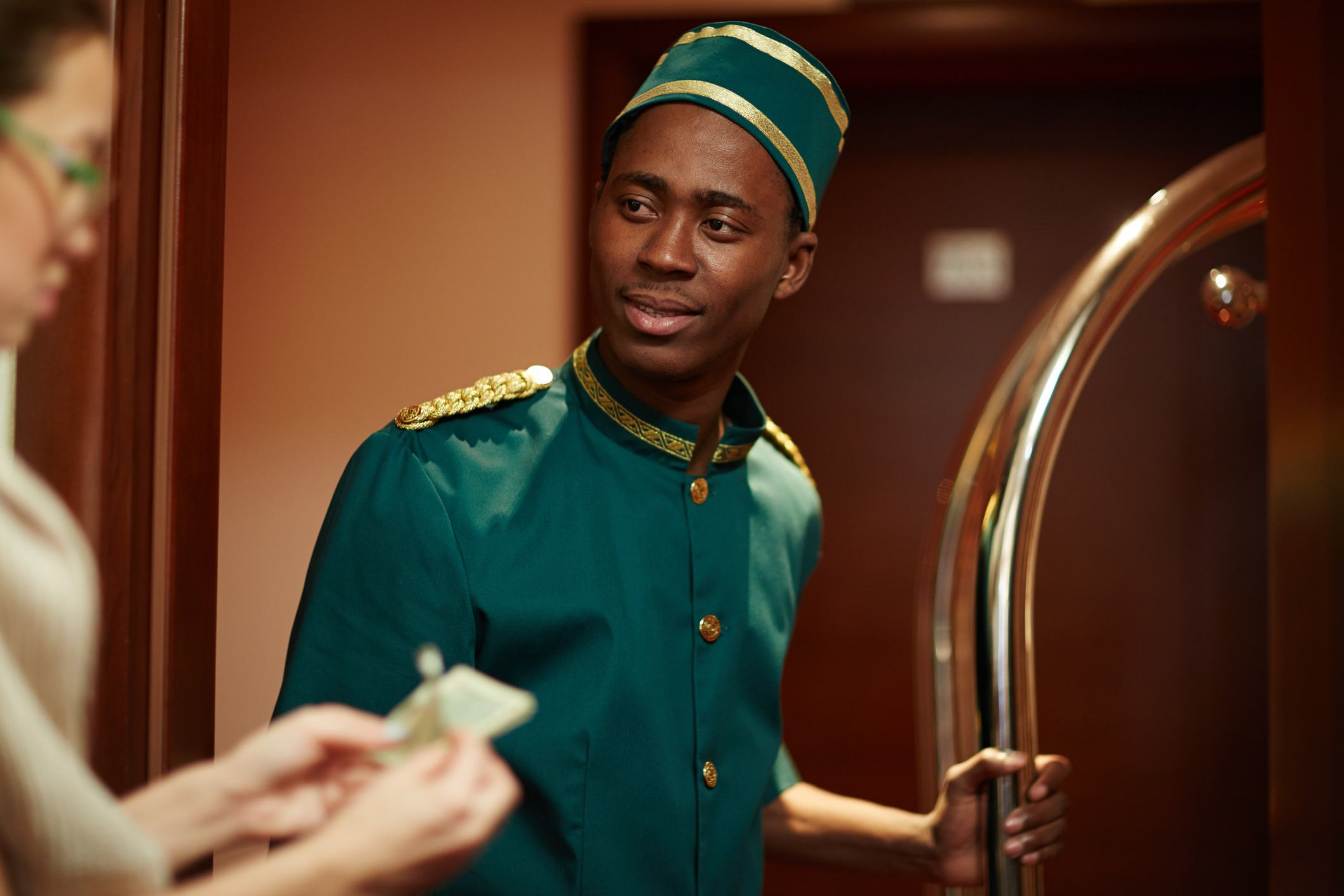 Bellboy Getting Tips from Guests