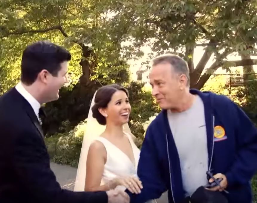 Tom Hanks greets the couple.