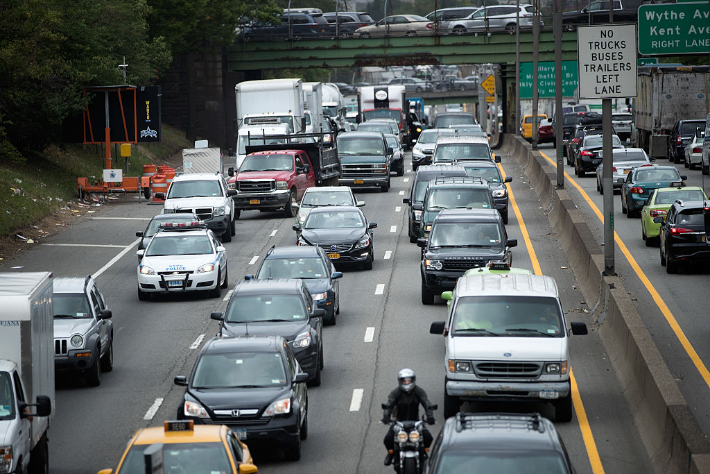 Traffic crawls on the Brooklyn-Queens Expressway (I-278), July 1, 2016 in the Brooklyn borough of New York City. Officials from the American Automobile Association (AAA) are predicting 44 million people will travel by roads, airports, buses, and train this holiday weekend. Gas prices for the July 4th weekend are the lowest they've been in 11 years.