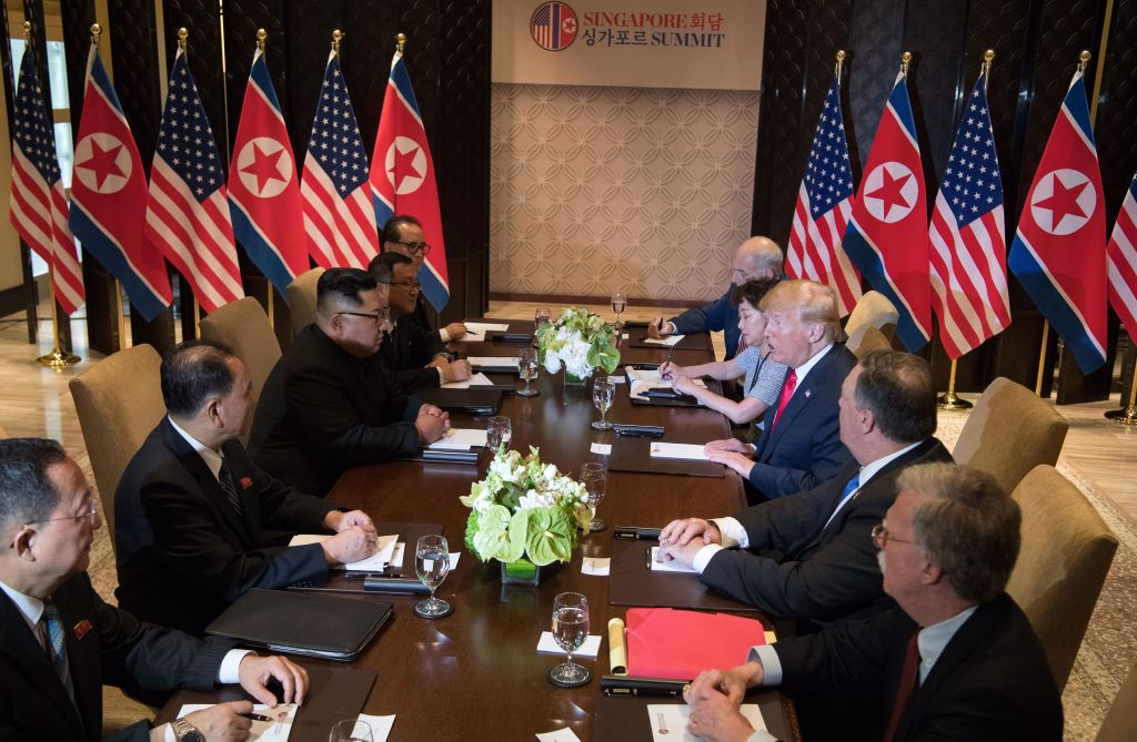 US President Donald Trump (3rd R) and North Korea's leader Kim Jong Un