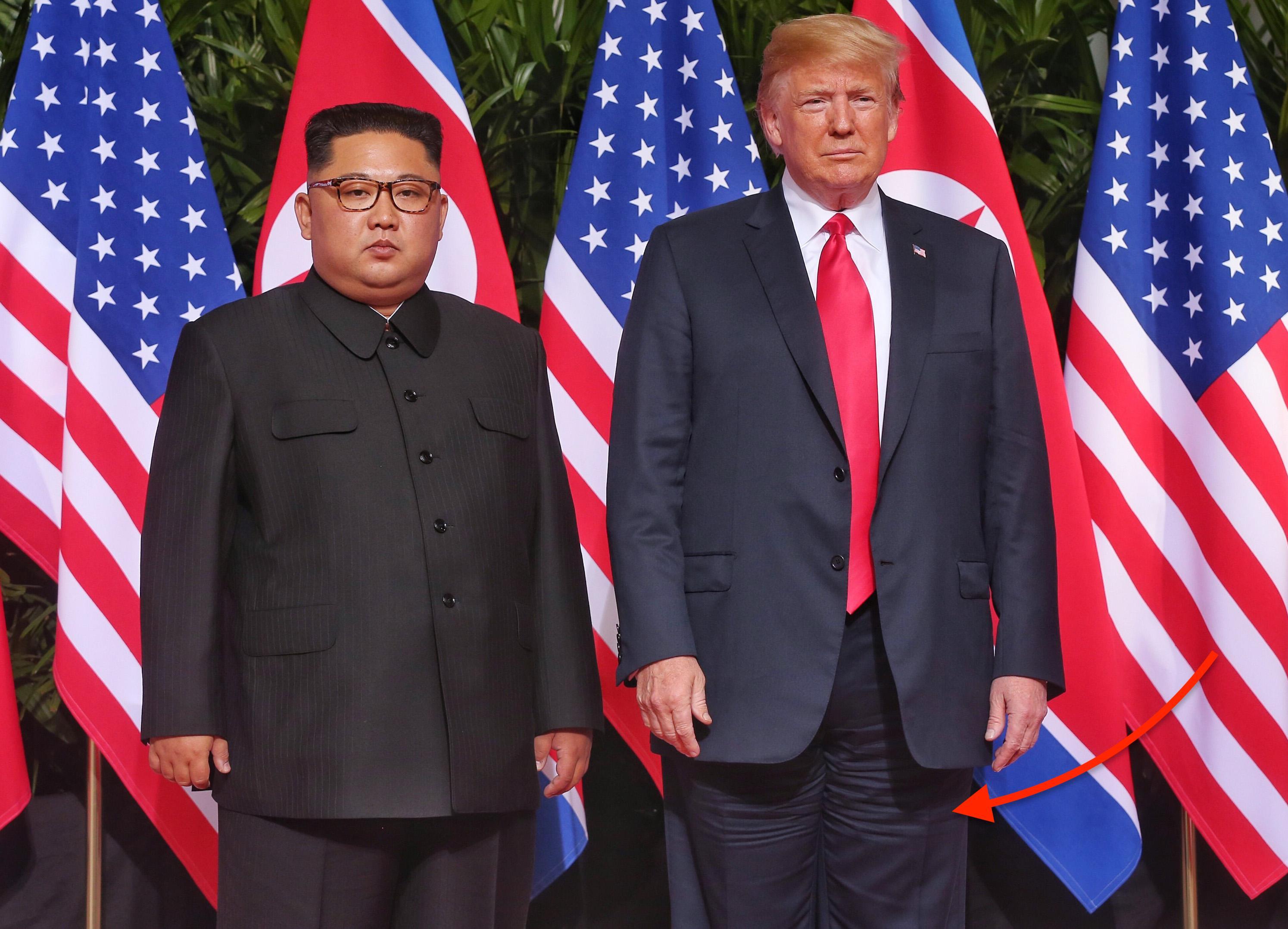 U.S. President Trump Meets North Korean Leader Kim Jong-un During Landmark Summit In Singapore focus on suit wrinkles
