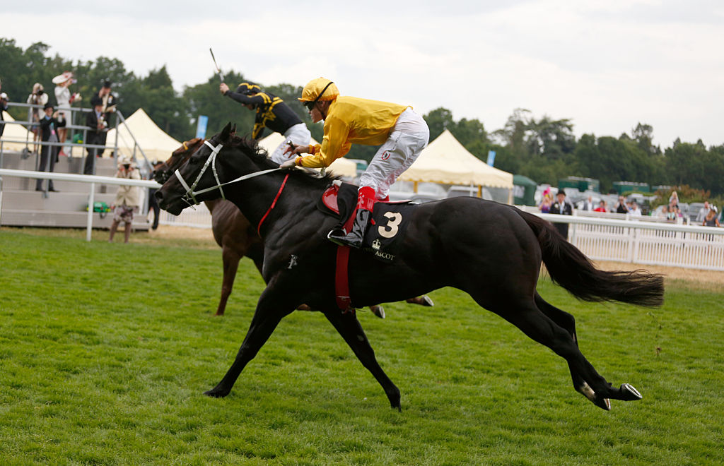 Frankie Dettori riding Undrafted and runner up Craig A. Williams riding Brazen Beau during day 5 of Royal Ascot