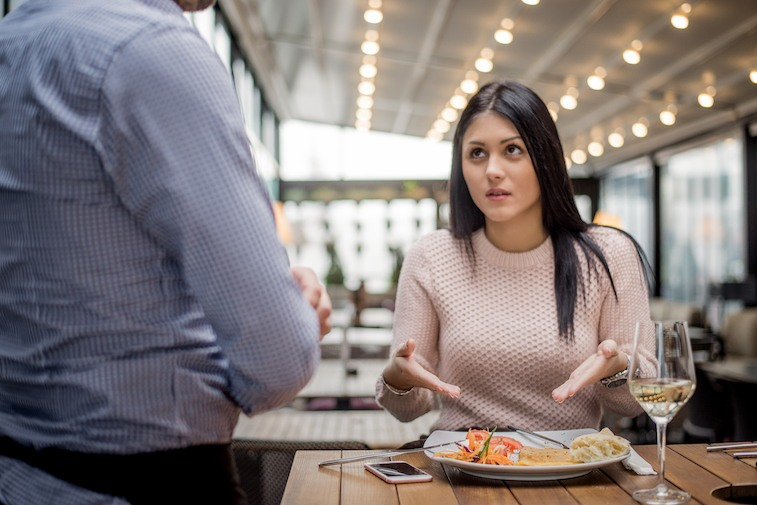 Unhappy customer with her meal Portrait of woman complaining about food quality in restaurant.