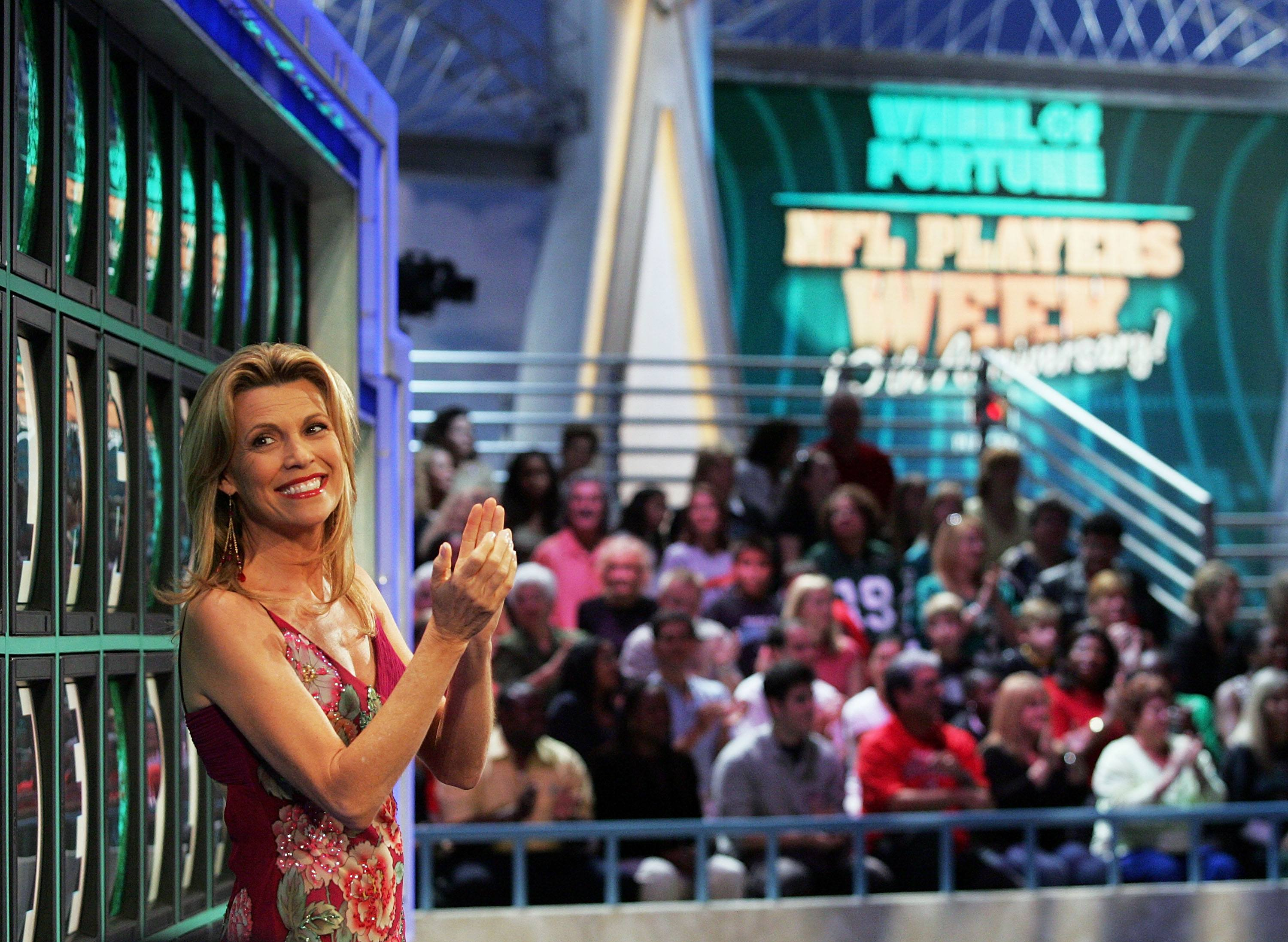NFL Players Compete On Wheel Of Fortune Vanna White