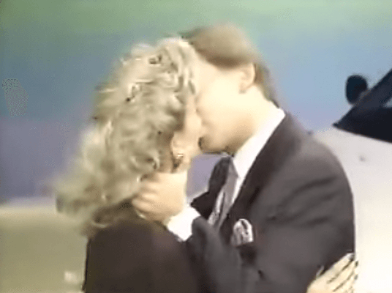Vanna White and Pat Sajak kissing