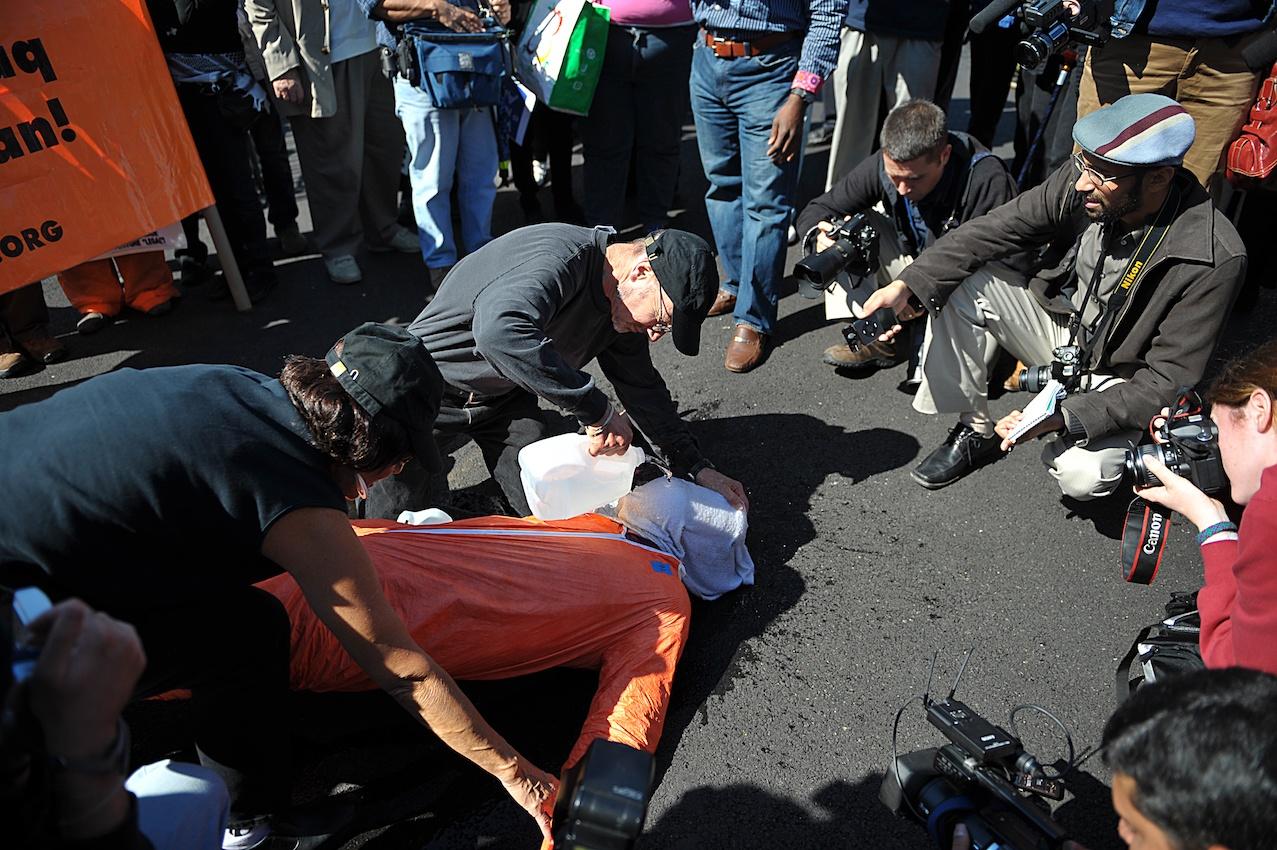 Anti-war activists demonstrate waterboar