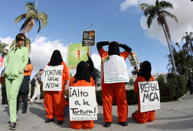 Demonstrators dressed as Guantanmo priso