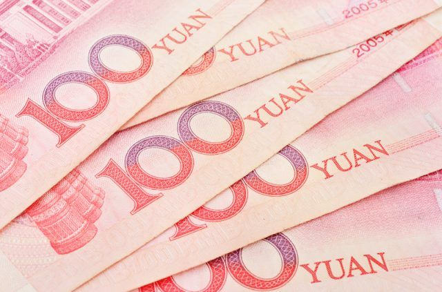 Yuan bills seen laid out.