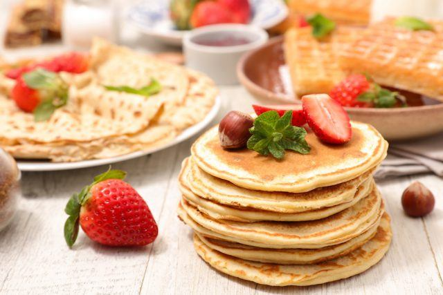 assorted pancakes, waffles, and crepes