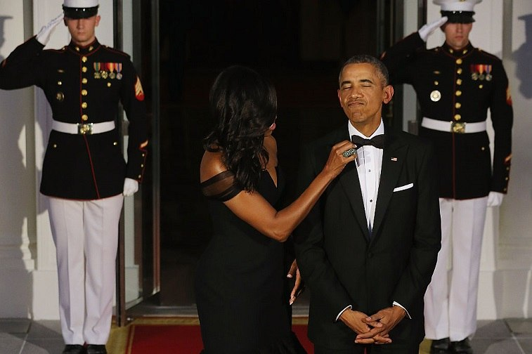 President Barack Obama and U.S. first lady Michelle Obama pose for photographers on the North Portico ahead of a state dinner at the White House September 25, 2015 in Washington, DC.