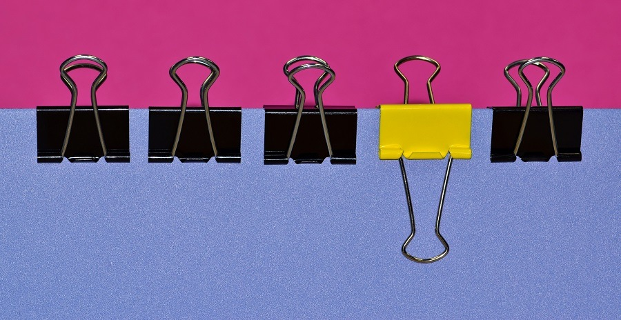 A row of black binder clips