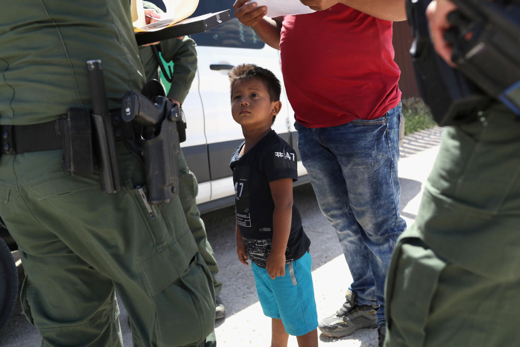 A boy and father from Honduras are taken into custody by U.S. Border Patrol agents near the U.S.-Mexico border.
