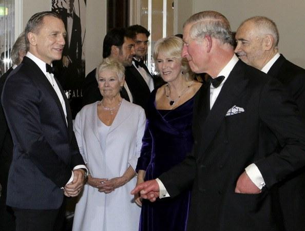 Prince Charles and Camilla meet British actors Daniel Craig and Judi Dench.