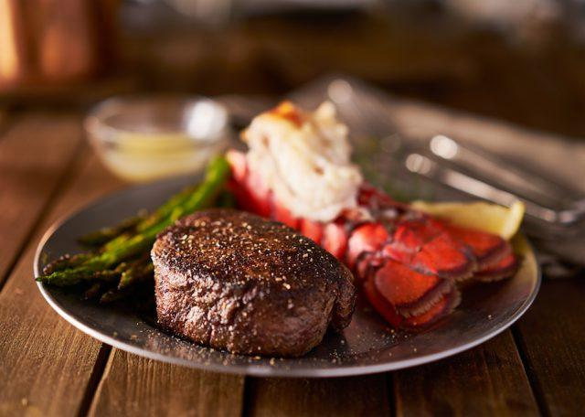 Steak with lobster and vegetables