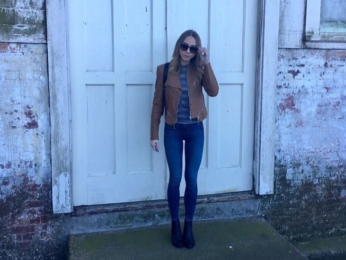 Hailie Scott in front of a wall