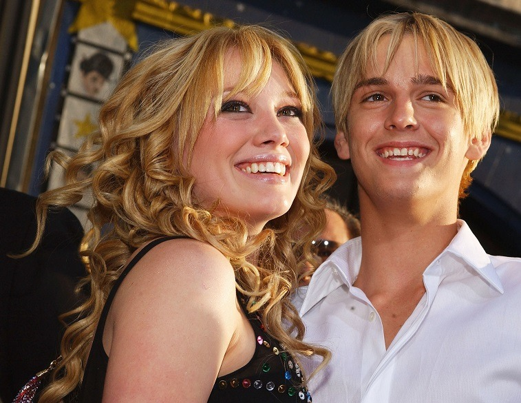 Actress Hilary Duff hugs singer Aaron Carter as they attend the premiere of The Lizzie McGuire Movie on April 26, 2003 in Hollywood, California.