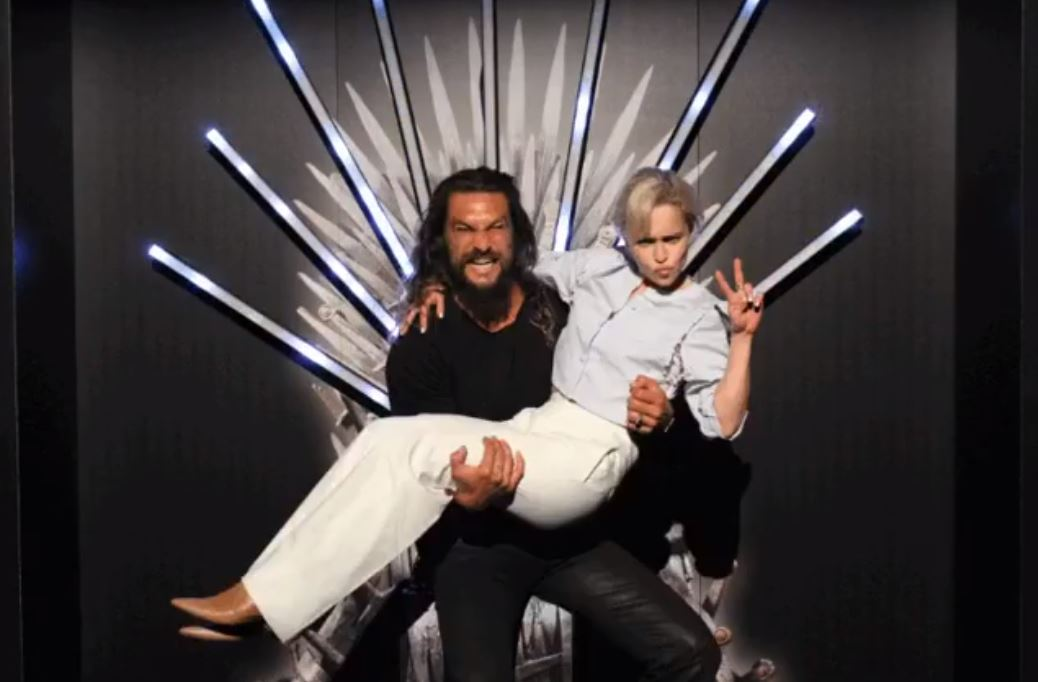 Jason Momoa and Emilia Clarke on the Iron Throne