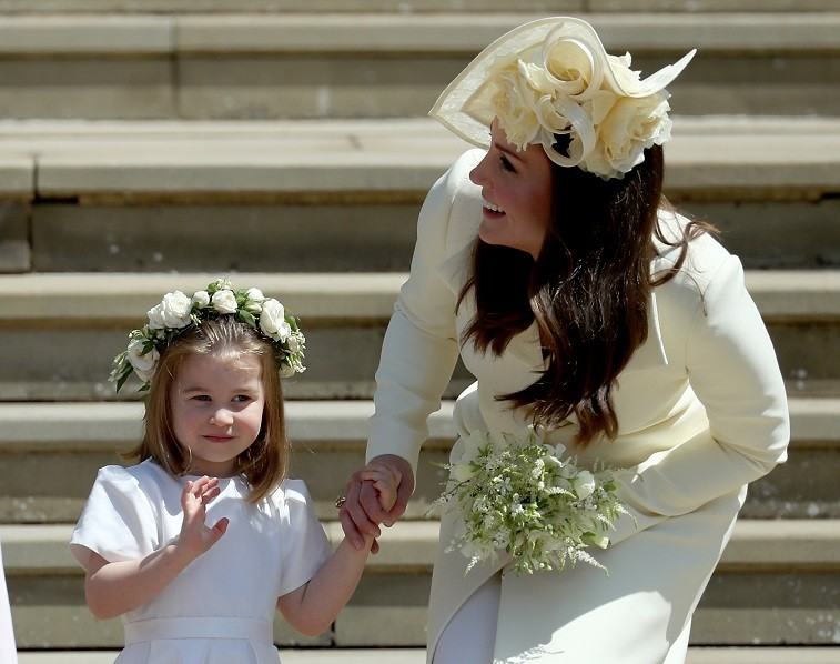 Princess Charlotte of Cambridge stands on the steps with her mother Catherine, Duchess of Cambridge after the wedding of Prince Harry and Ms. Meghan Markle at St George's Chapel at Windsor Castle on May 19, 2018 in Windsor, England.