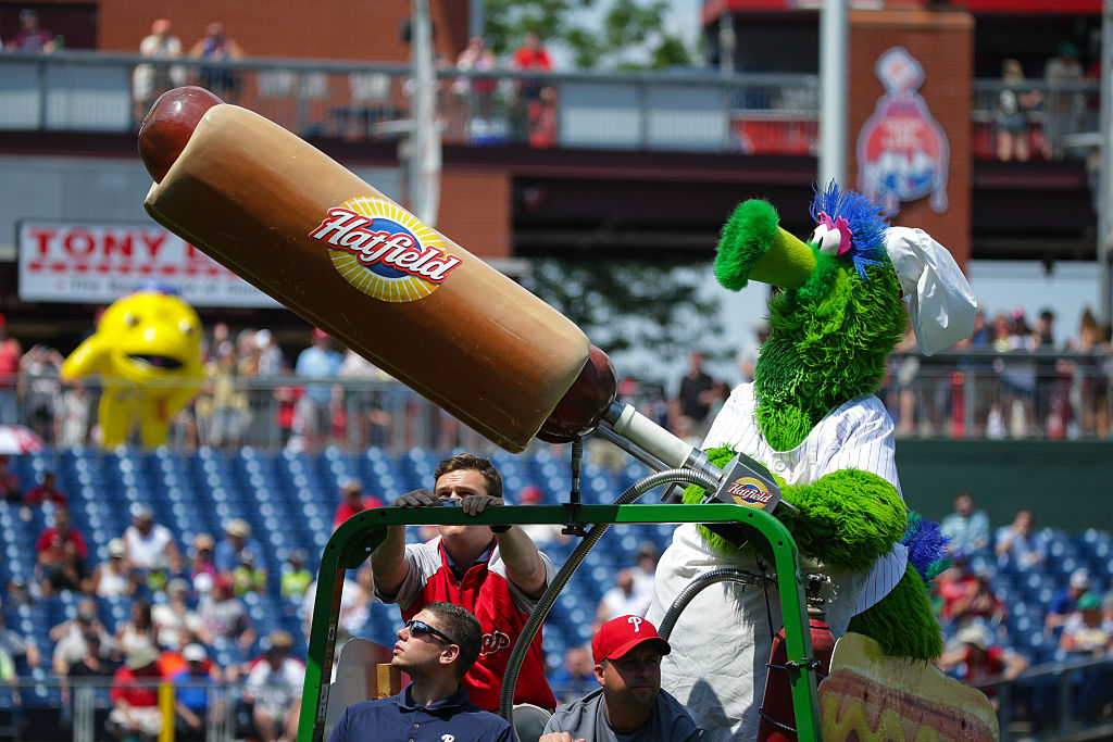 The Phillie Phanatic launches Hatfield hotdogs into the stands.