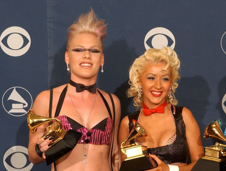 """Pink and Christina Aguilera hold their Best Pop Collaboration With Vocals for """"Lady Marmalade"""" award during the 44th Annual Grammy Awards on February 27, 2002."""