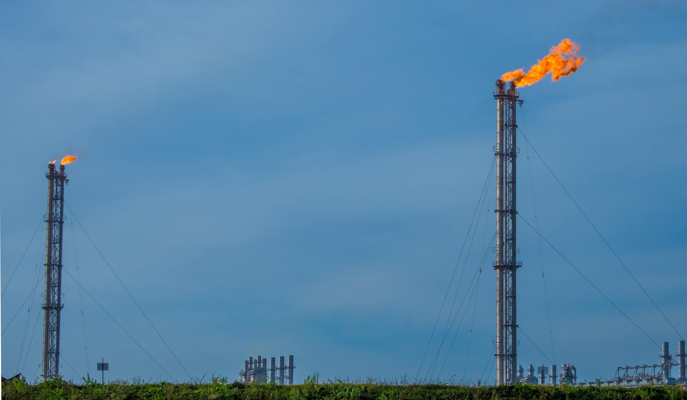 Flare stacks at a petroleum refinery in Port Arthur, Texas