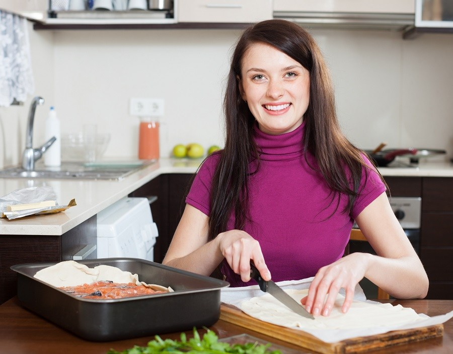Woman cutting premade pie crust