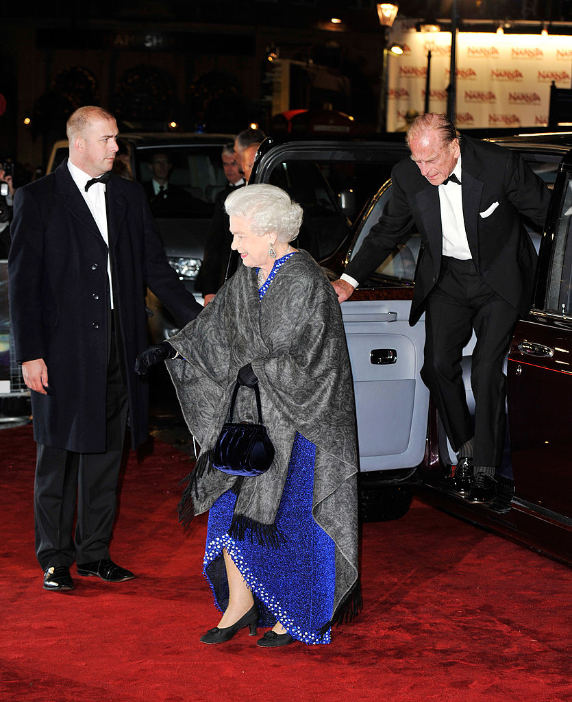 Queen Elizabeth and Prince Philip arrive on the red carpet.