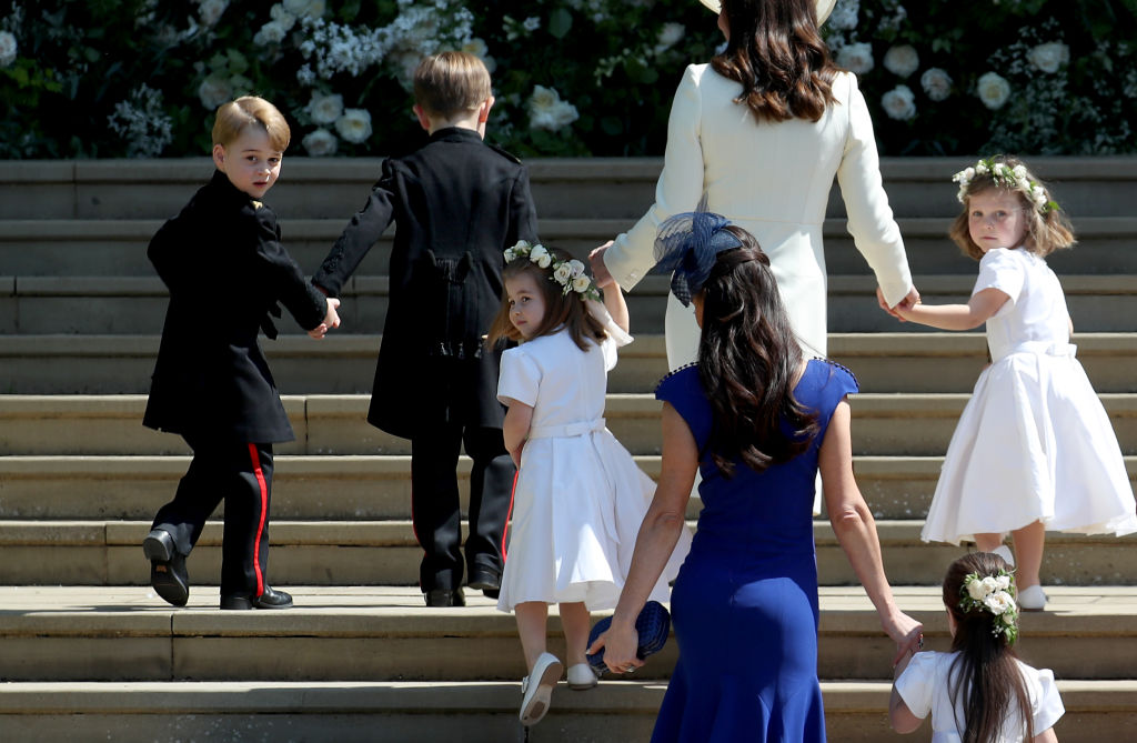 The royal wedding party heads up the steps to the church.