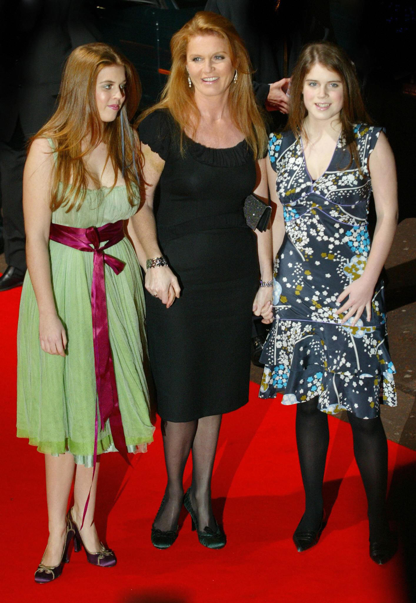 Sarah Ferguson, Princess Beatrice, and Princess Eugenie arrive on the red carpet.