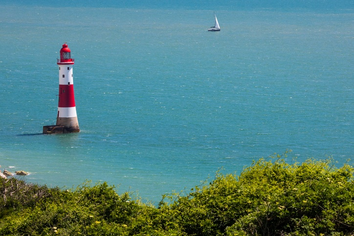 A view of Beachy Head Lighthouse on the English Channel in East Sussex, UK.
