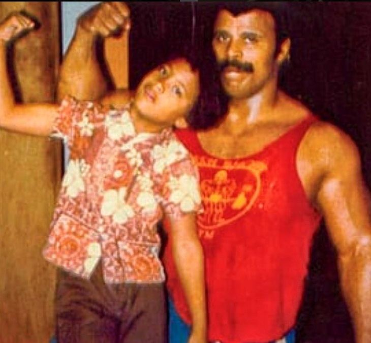 Dwayne Johnson photographed with his father