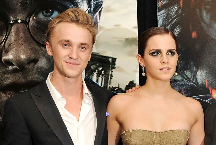 """Tom Felton and Emma Watson attend the New York premiere of """"Harry Potter And The Deathly Hallows: Part 2"""" at Avery Fisher Hall, Lincoln Center on July 11, 2011 in New York City."""