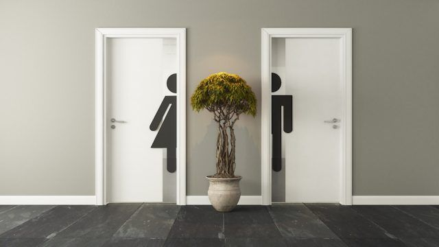 White men's and women's restroom doors