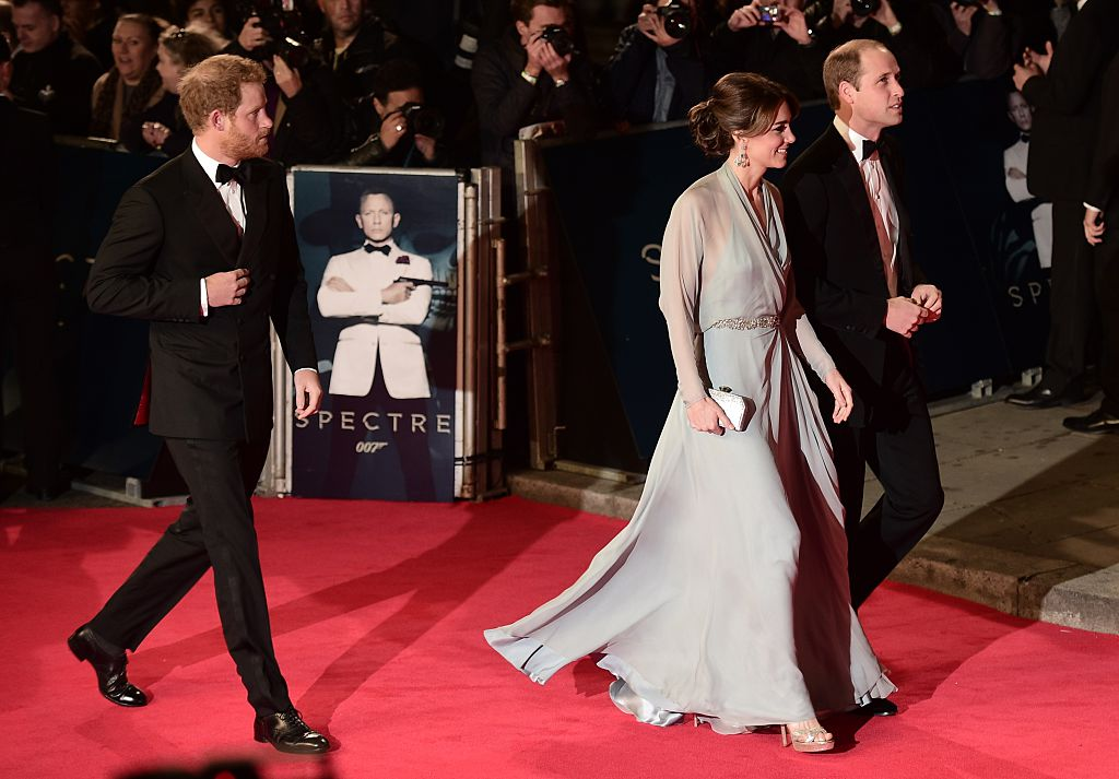Prince William, Kate Middleton, and Prince Harry arrive on the red carpet.